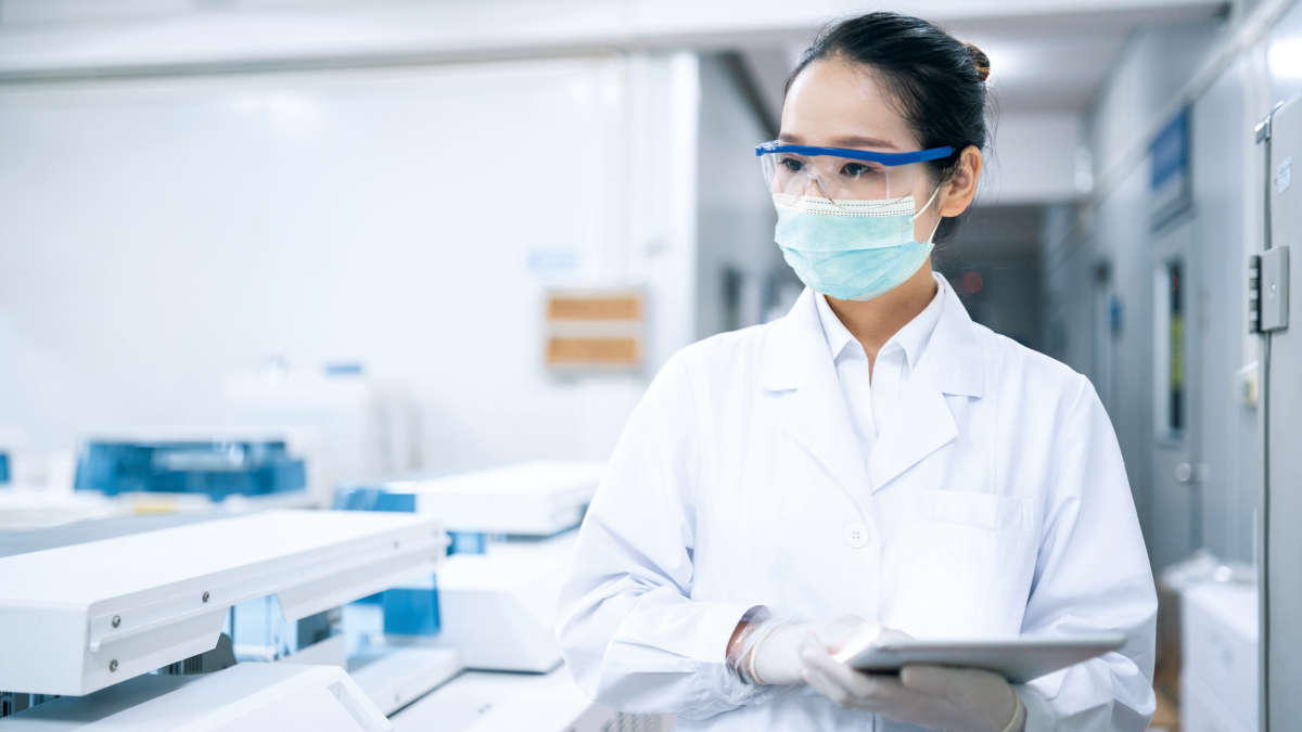 scientist, laboratory, labworker, check, reaserch, monitor, round, machine, instrument, female asian scientist in a lyb inviroment wearing a mask